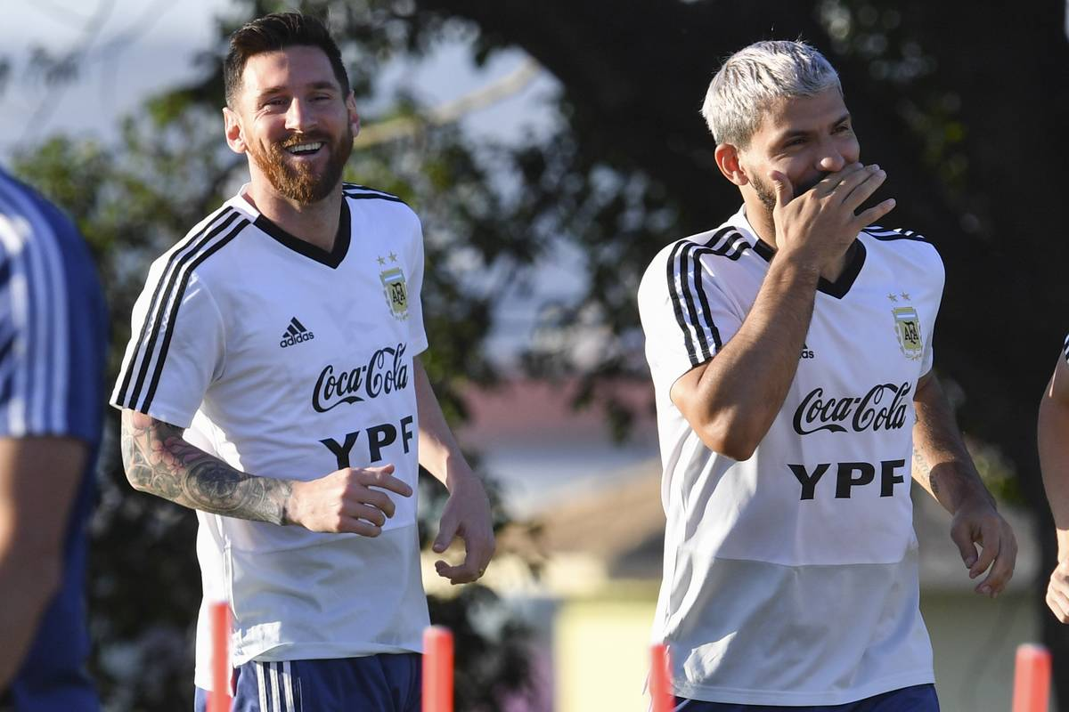 Argentina's Lionel Messi and Argentina's Sergio Aguero laugh as they train during a practice session in Belo Horizonte, Brazil