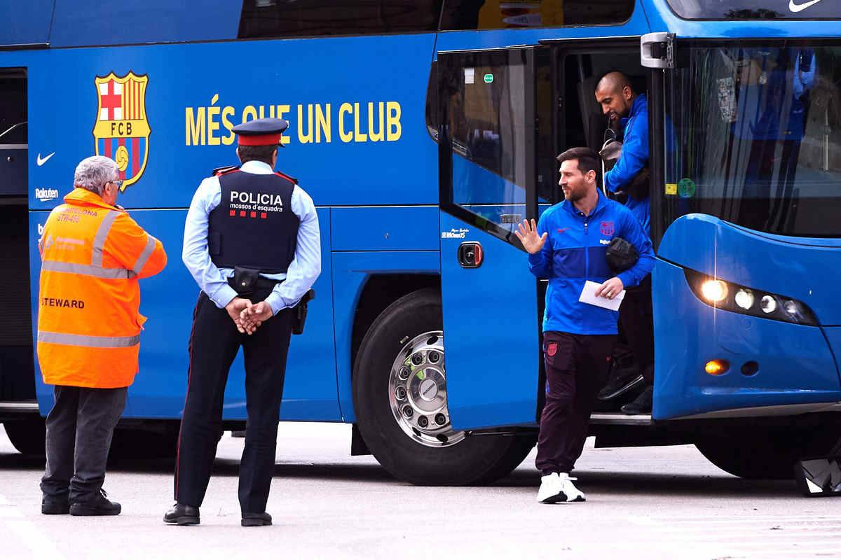 Arturo Vidal and Lionel Messi of FC Barcelona arrive at Hotel Sofia with the team bus ahead of the Liga match between FC Barcelona and Real Madrid CF near Camp Nou on December 18, 2019 in Barcelona, Spain.