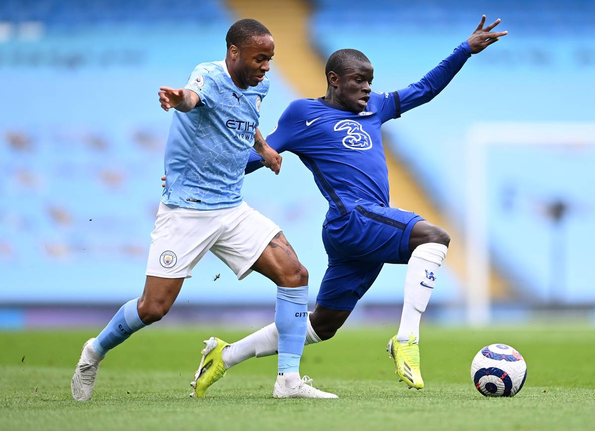 N'Golo Kante of Chelsea stretches for the ball under pressure from Raheem Sterling of Manchester City during the Premier League match between Manchester City and Chelsea at Etihad Stadium on May 08, 2021 in Manchester, England.