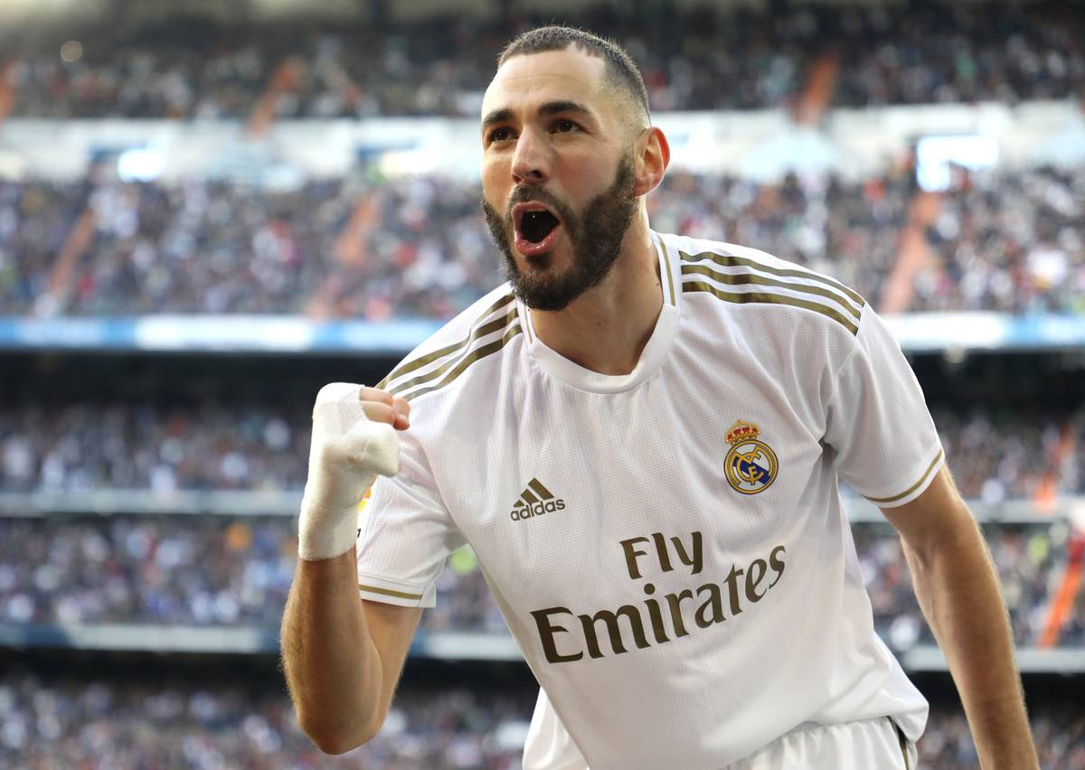 Karim Benzema of Real Madrid celebrates after scoring his team's first goal during the La Liga match between Real Madrid CF and Club Atletico de Madrid at Estadio Santiago Bernabeu on February 01, 2020 in Madrid, Spain