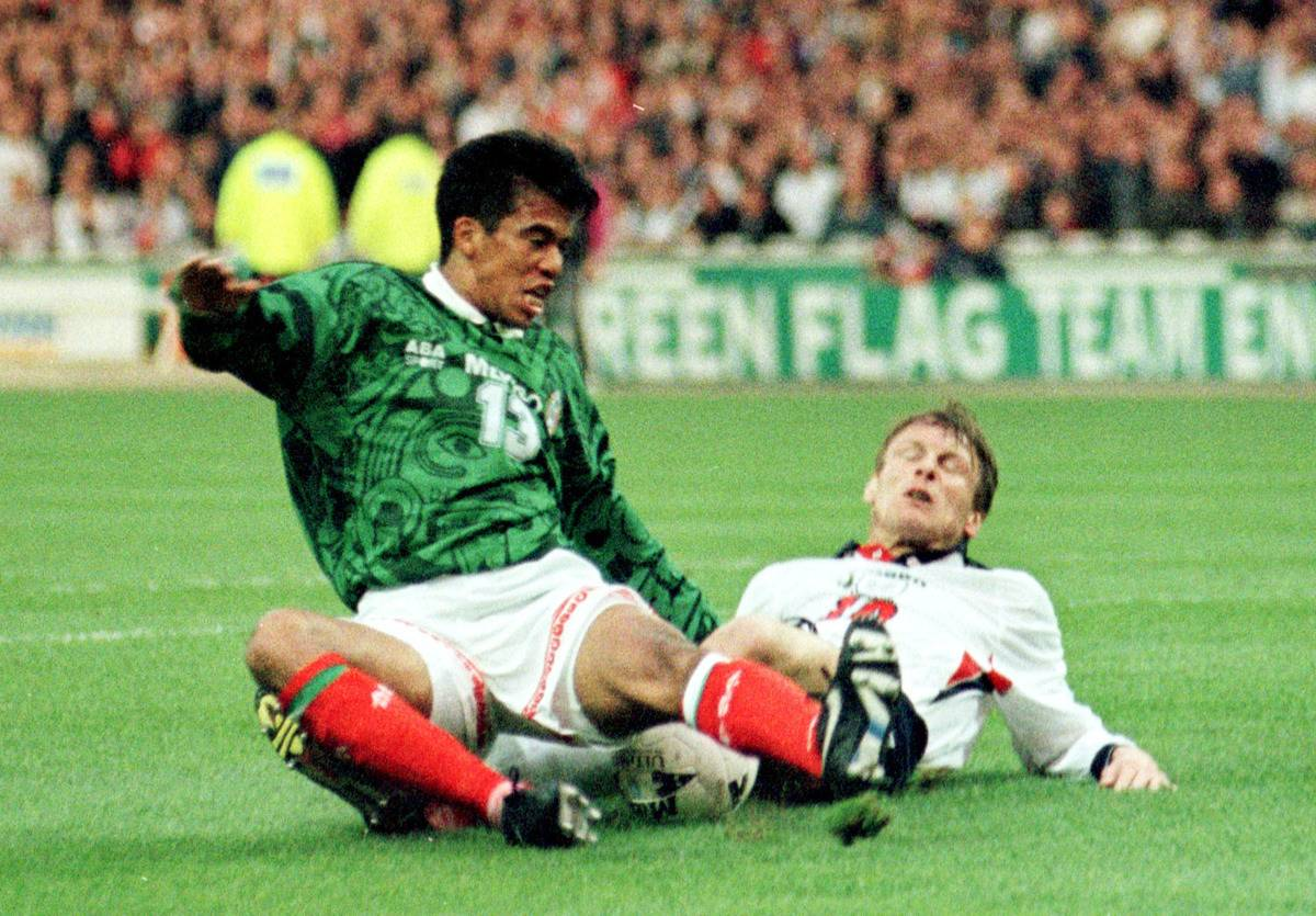 Pavel Pardo of Mexico brings down Teddy Sheringham in the penalty box during afriendly at Wembley.