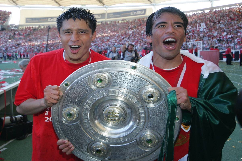 Pavel Pardo - Defender, VfB Stuttgart, Mexico - holding the Bundesliga trophy with team-mate Ricardo Osorio (L) after winning the German championship