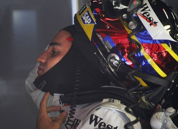 McLaren-Mercedes Colombian driver Juan Pablo Montoya wears his helmet in the pits of the Catalunya racetrack during the third free practice session, on the eve of the Spain Grand Prix, 07 May 2005 in Montmelo, Spain