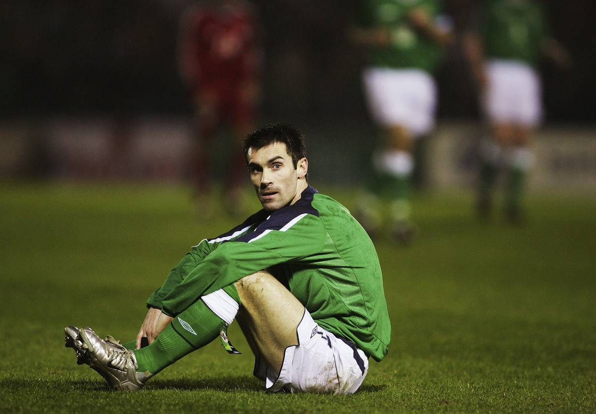 Keith Gillespie of Northern Ireland sits on the pitch after a missed opportunity during the International Challenge match between Northern Ireland and Canada at Windsor Park on February 9, 2005 in Belfast, Northern Ireland