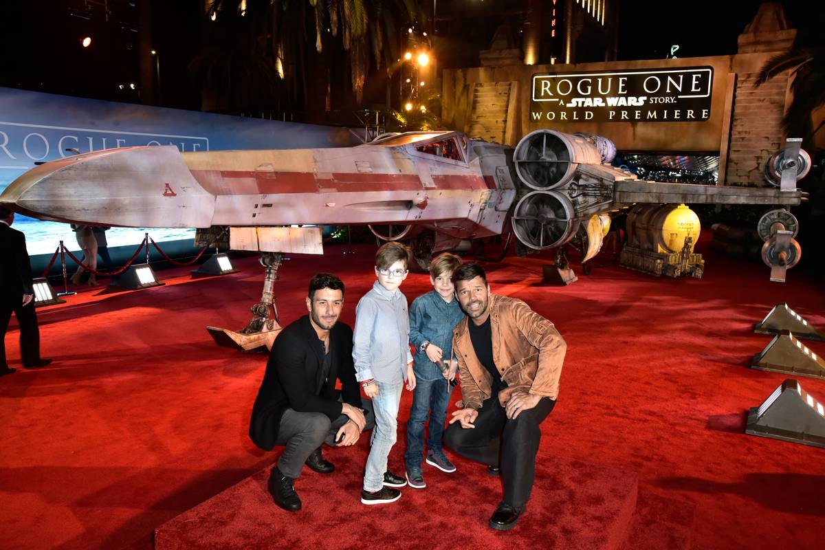 Singer Ricky Martin (R) with children and artist Jwan Yosef (L) attend The World Premiere of Lucasfilm's highly anticipated, first-ever, standalone Star Wars adventure,