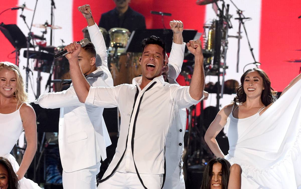 In this handout photo provided by One Voice: Somos Live!, singer Ricky Martin performs onstage during