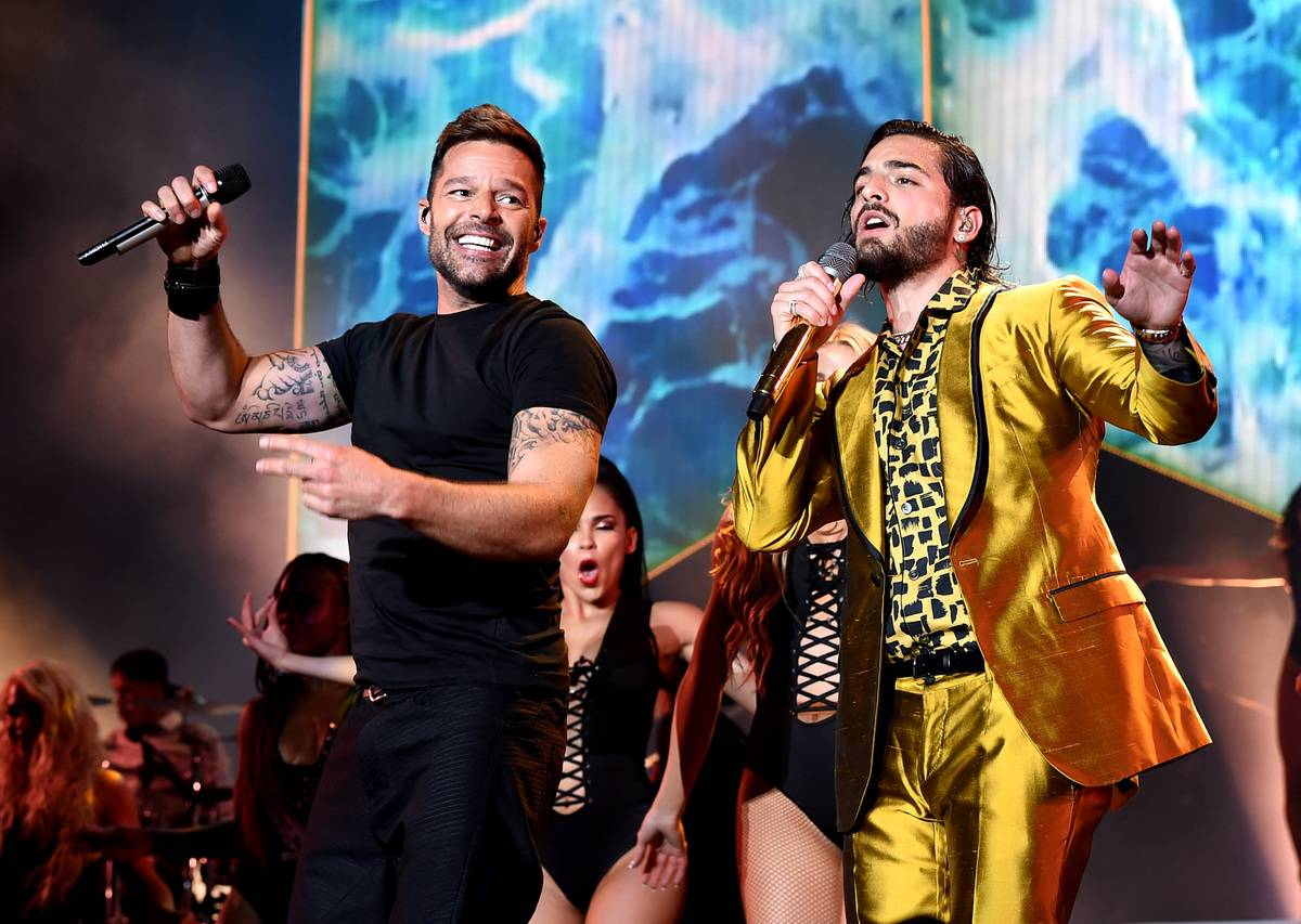 Singer Maluma (R), with singer Ricky Martin (L), performs during his