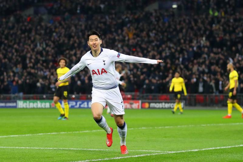 Son Heung-Min of Tottenham celebrates scoring to make it 1-0 during the UEFA Champions League Round of 16 First Leg match between Tottenham Hotspur and Borussia Dortmund at Wembley Stadium on February 13, 2019 in London, England