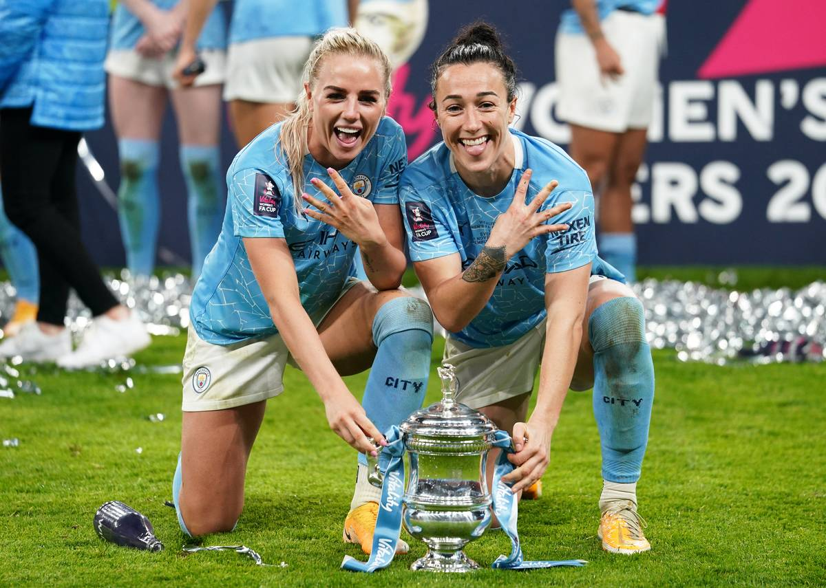 Alex Greenwood and Lucy Bronze of Manchester City celebrate with the trophy during the Vitality Women's FA Cup Final match between Everton Women and Manchester City Women at Wembley Stadium on November 01, 2020 in London, England
